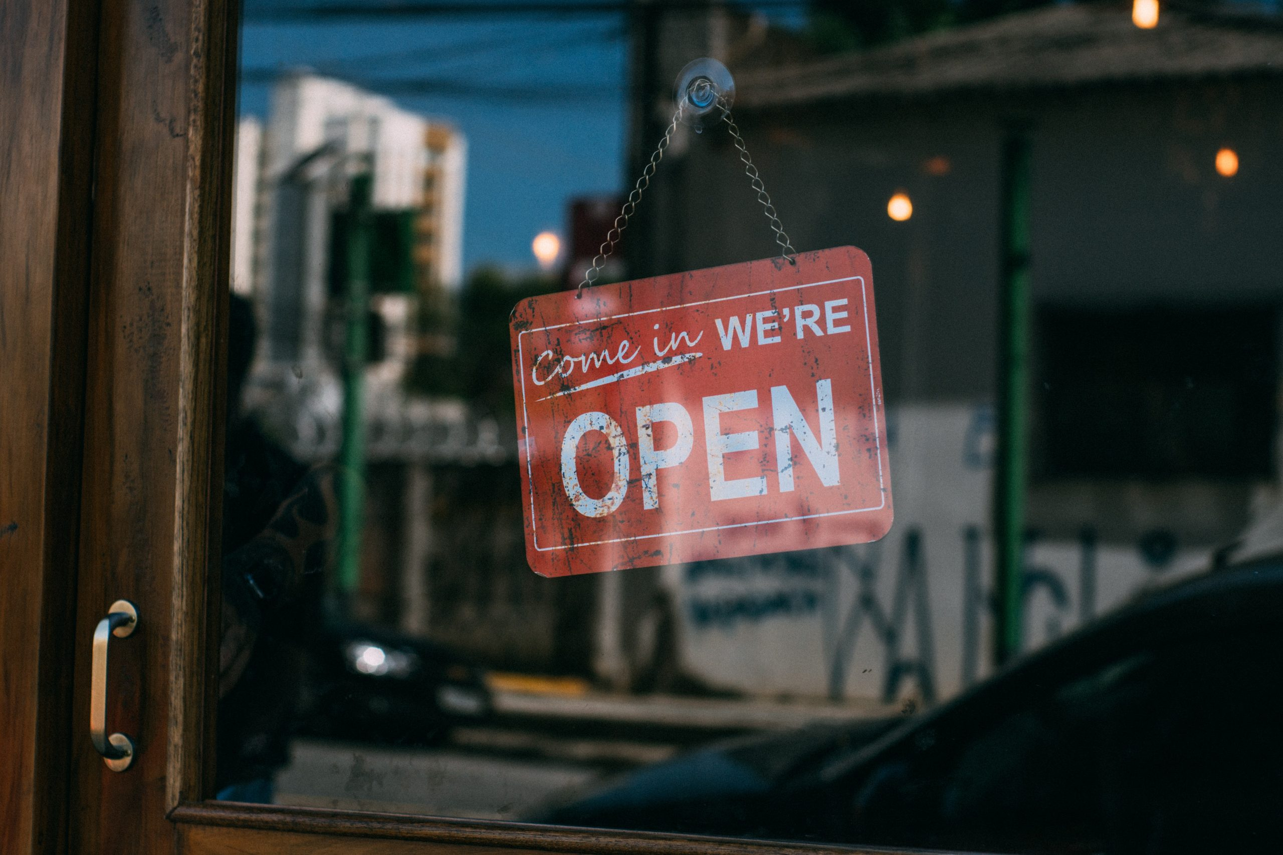 Come-in-we-are-open-sign-on-small-business-shop
