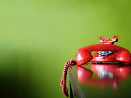 red-rotary-telephone-being-replaced-by-voip