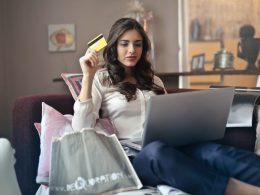 woman-holding-credit-card-while-shopping-online