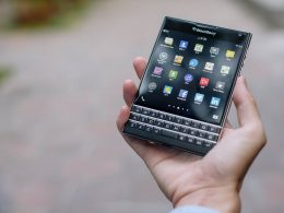 man-holding-blackberry-passport-smartphone-in-hand