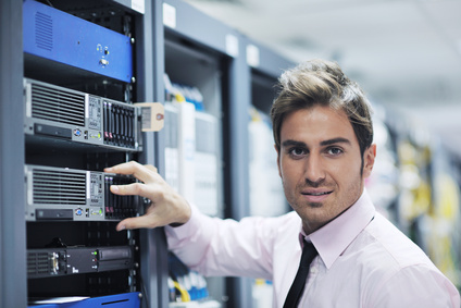 A young Managed IT Services Orlando engineer in data center